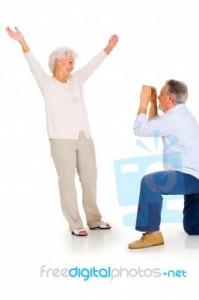 elderly-couple-taking-photograph-10044375