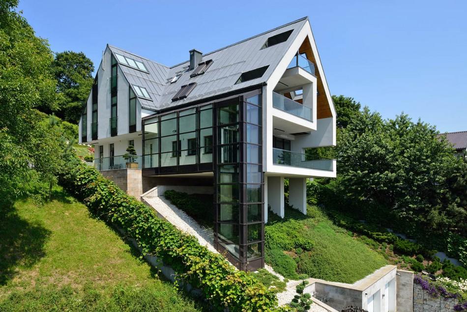 glass-elevator-multiple-levels-slope-house-1